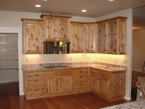knotty-alder-wood-kitchen-cabinets-l-05dd9069abcb7e7d